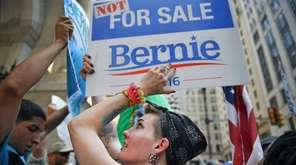 Bernie Sanders supporters gather at City Hall in