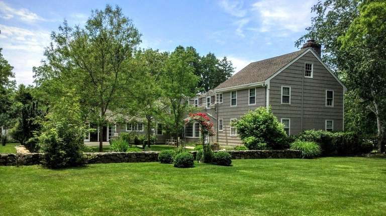 This more than 3,200-square-foot Colonial on 1.3 acres