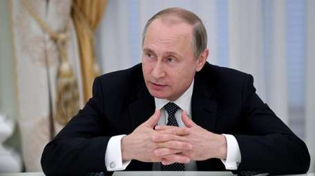 Russia's President Vladimir Putin attends a meeting with