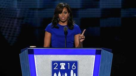First Lady Michelle Obama takes the stage during