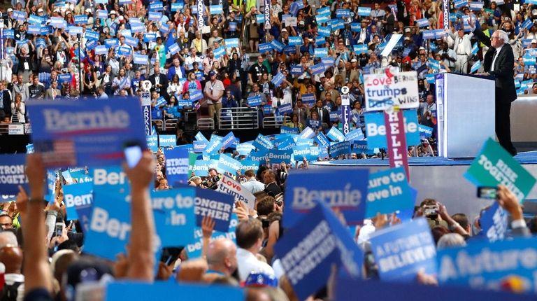 Sen. Bernie Sanders acknowledges the crowd before delivering