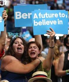 Supporters of Sen. Bernie Sanders stand and cheer