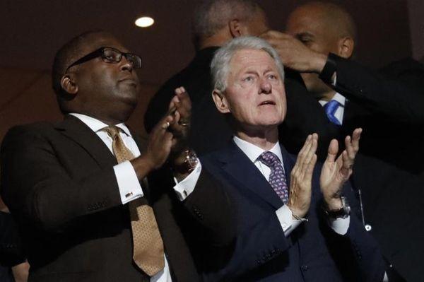 Former President Bill Clinton applauds as first lady