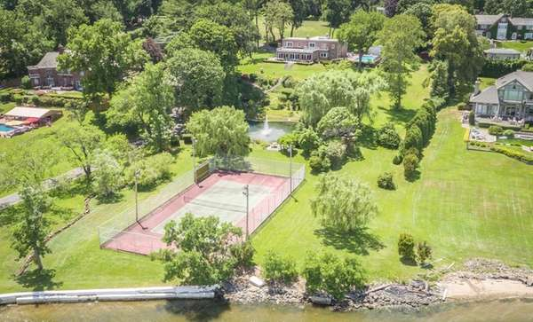 This Kings Point property includes a pond with