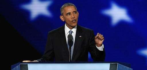 President Barack Obama waves as he walks on
