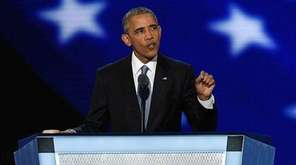 President Barack Obama waves as he walks on
