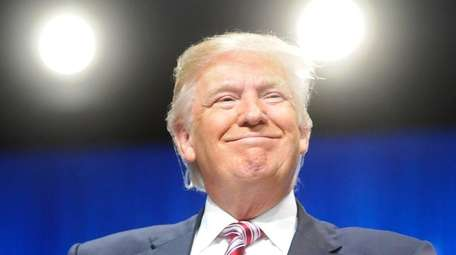 Republican presidential candidate Donald Trump addresses an audience