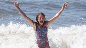 Abby Claps, 11, of Kings Park splashes around