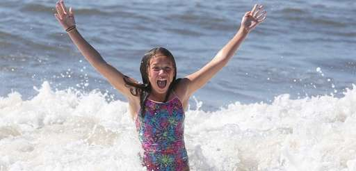 Abby Claps, 11, of Kings Park splashes around