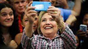 Democratic presidential candidate Hillary Clinton takes photographs with