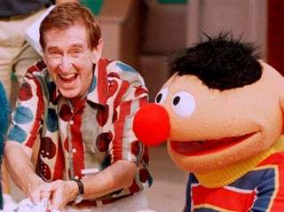 Sesame Street actor Bob McGrath cuts a 30th