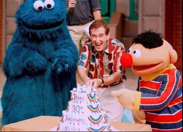 Sesame Street actor Bob McGrath cuts a 30th