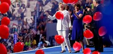 Democratic presidential candidate Hillary Clinton stands with her