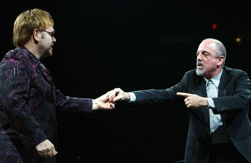 Oct. 13 (2002): Joel and Elton John perform