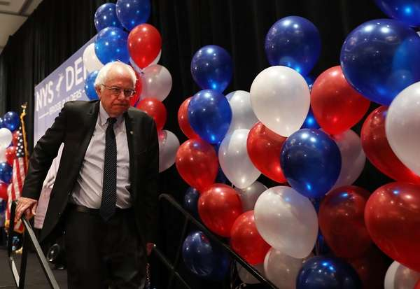 Sen. Bernie Sanders exits the stage after addressing