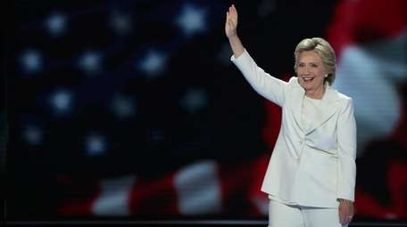 Democratic presidential nominee Hillary Clinton waves to the