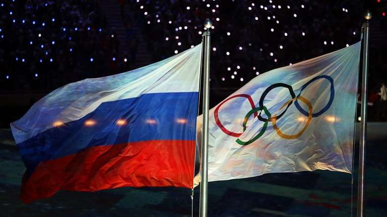 The Olympic flag and the Russian flag during