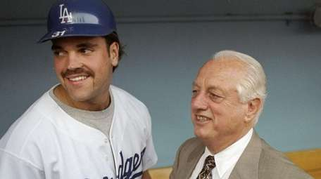 Former manager Tommy Lasorda and catcher Mike Piazza
