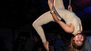 Alexandria Grime, left, of Circus Central performs her