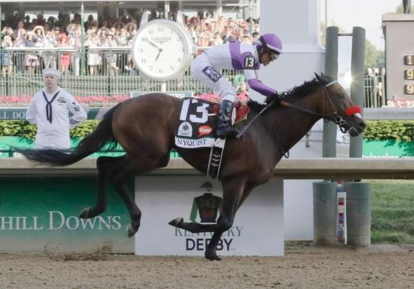 Mario Guitierrez rides Nyquist to victory during the