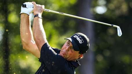 Phil Mickelson of the US hits his tee