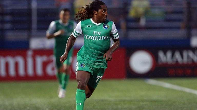 Cosmos' Lucky Mkosana controls the ball against Puerto