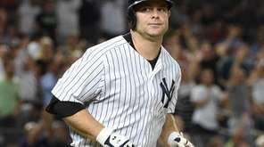 New York Yankees catcher Brian McCann runs on