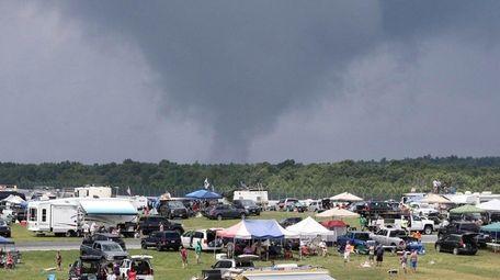 Dark rain clouds move in over the fan