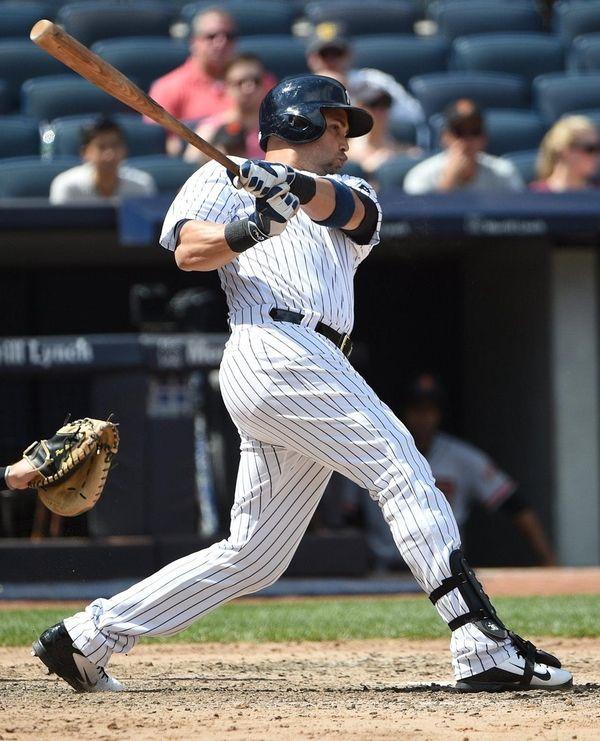 New York Yankees designated hitter Carlos Beltran singles