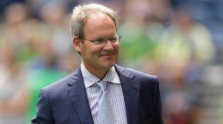 Seattle Sounders interim coach Brian Schmetzer walks on
