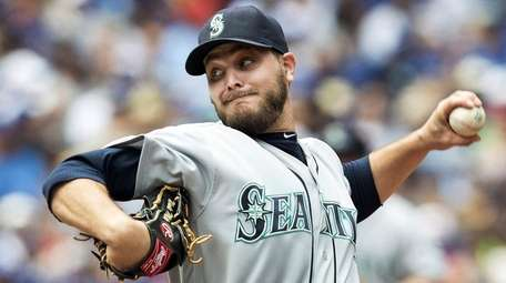 Seattle Mariners starting pitcher Wade Miley throws against