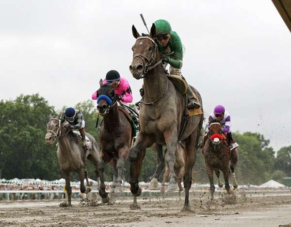 Exaggerator, foreground, with Kent Desormeaux riding, gets