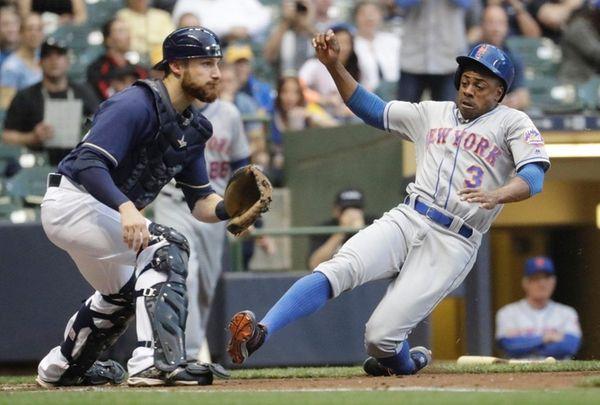 New York Mets' Curtis Granderson slides safely past
