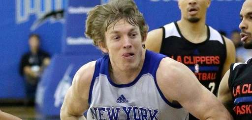 New York Knick's Ron Baker, center, drives between