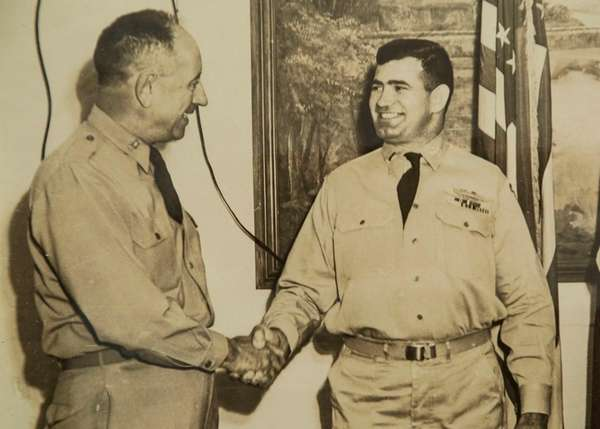 Chief Warrant Officer Adolphus David Nava, right, while