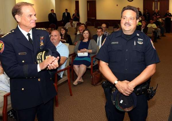 Police Officer Nicolas Felitti, right, was named