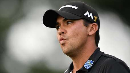 Jason Day of Australia reacts on the 13th