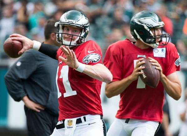 Rookie quarterback Carson Wentz, left, and apparent starter