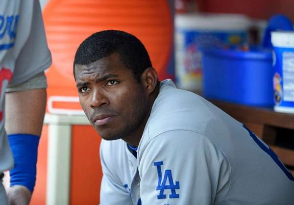 Los Angeles Dodgers' Yasiel Puig looking on from