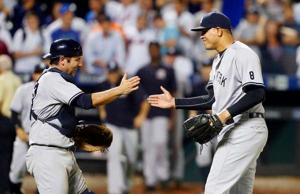 Dellin Betances #68 and Austin Romine #27 of