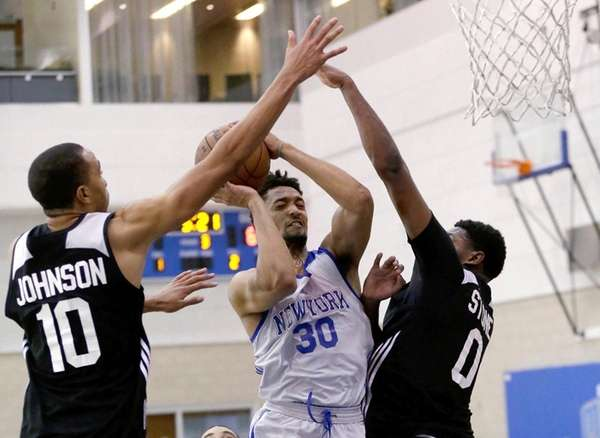 New York Knicks' J.P. Tokoto goes up for
