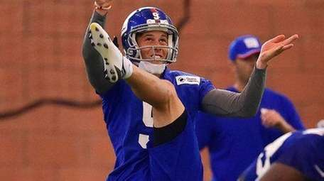 New York Giants punter Brad Wing punts the