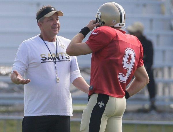 New Orleans Saints head coach Sean Payton, left,