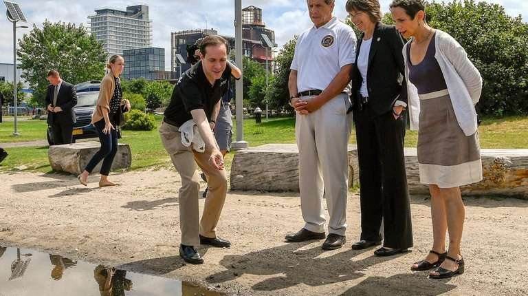 Gov. Andrew M. Cuomo, in white shirt, with