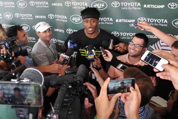 New York Jets receiver Brandon Marshall speaks with