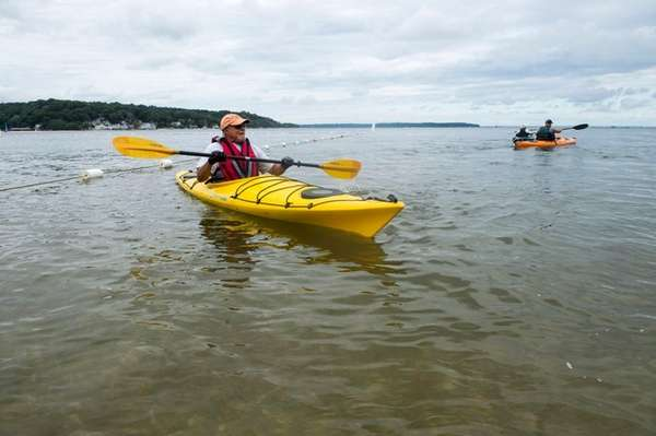 Carl Cascone, of Northport, kayaks out of Centerport