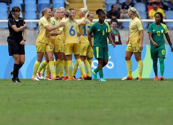 Sweden's players celebrate after Nilla Fischer scored her