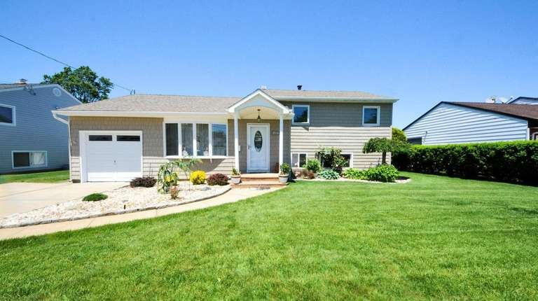 This Massapequa split-level, listed for $574,999 in August