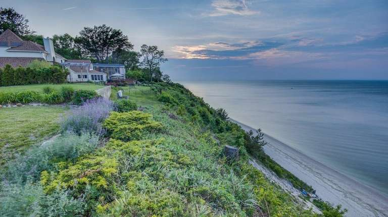 This Rocky Point Colonial, listed for $669,000 in