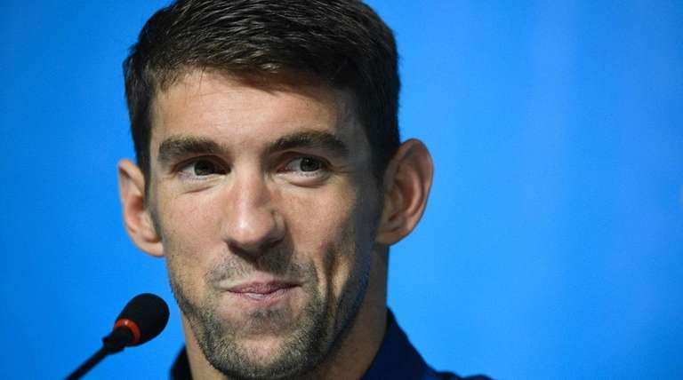U.S. swimmer Michael Phelps holds a press conference